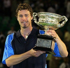 File photo of Russia's Marat Safin holding 2005 Australian Open championship trophy