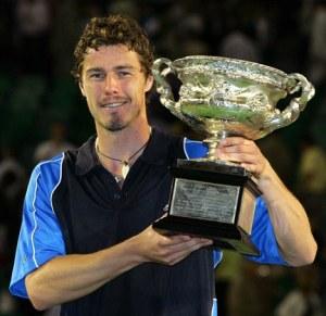 File photo of Russia's Marat Safin holding 2005 Australian Open championship trophy